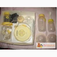 Молокоотсос электрический Медела Medela+накладкии для груди+бутылочки для молока продаю.